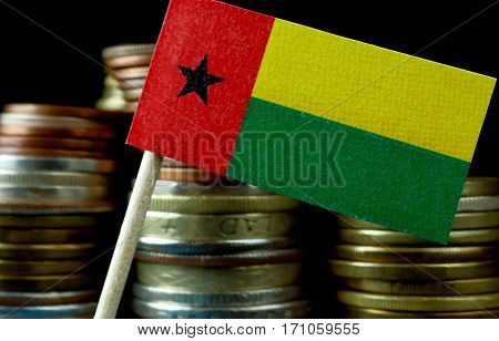 Guinea Bissau Flag Waving With Stack Of Money Coins Macro