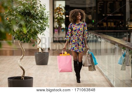 Good dressed afro-american woman in a shopping mall.