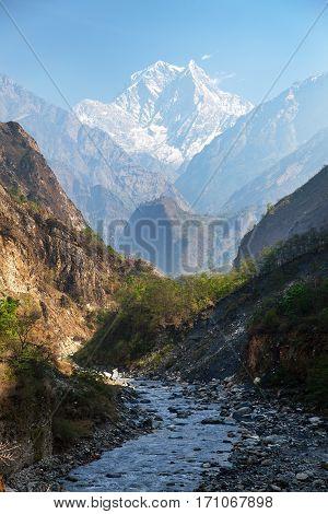 Mount Nilgiri and Kali Gandaki Nadi canyon round Annapurna circuit trekking trail mountain landscape annapurna region Nepal poster