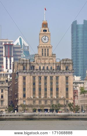 Customs House in the Bund, Shanghai, China. Customs House is a Greek-revival neo-classical building and was built in 1927. The building remains Shanghai customs house today.