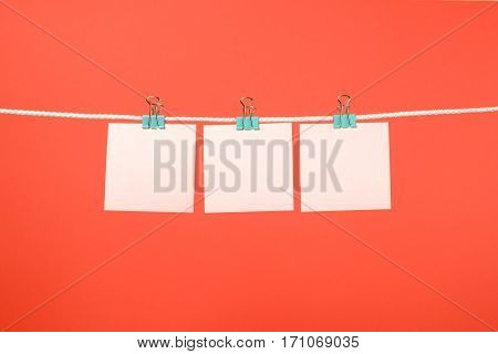 Blank Pink Paper Sheets Hanging On String