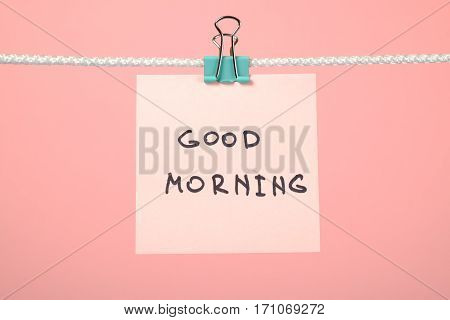 """Pink Paper Note On Clothesline With Text """"good Morning"""""""