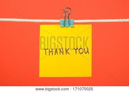 """Yellow Paper Note On Clothesline With Text """"thank You"""""""