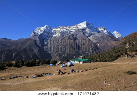 Syangboche airport and snow capped mountain. Old runway near Namche Bazar Everest National Park.