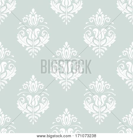 Seamless damask pattern. Traditional classic orient ornament. Light blue and white pattern