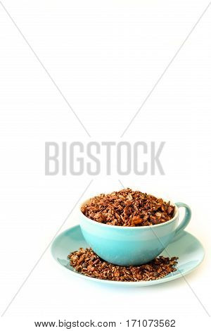 Chocolate granola from flakes of buckwheat, barley, rye and wheat, oatmeal, walnuts, pumpkin, sunflower and sesame seeds, flax, cinnamon, cocoa, sea salt, grape oil, syrup corn, hazelnut pineapple.
