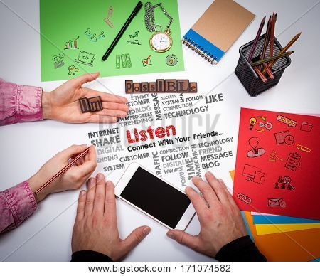 Listen Communication Listening Concept. The meeting at the white office table.