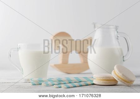 Jug Of Milk And Cup With Macaroons