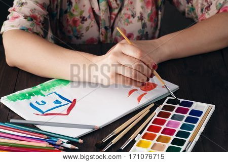 Woman Drawing House