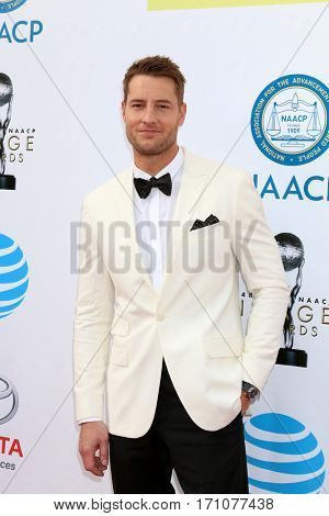 LOS ANGELES - FEB 11:  Justin Hartley at the 48th NAACP Image Awards Arrivals at Pasadena Conference Center on February 11, 2017 in Pasadena, CA