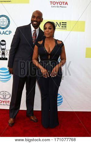 LOS ANGELES - FEB 11:  Jay Tucker, Niecy Nash at the 48th NAACP Image Awards Arrivals at Pasadena Conference Center on February 11, 2017 in Pasadena, CA