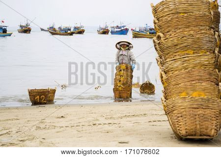 Mui Ne, Vietnam - February 7: Woman Washing Baskets For Anchovies Used For Fish Sauce On February 7,