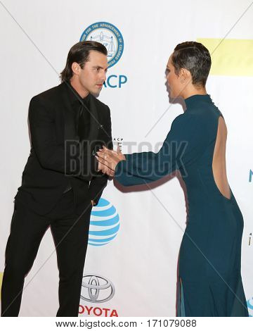 LOS ANGELES - FEB 11:  Milo Ventimiglia, Grace Gealey Byers at the 48th NAACP Image Awards Arrivals at Pasadena Conference Center on February 11, 2017 in Pasadena, CA