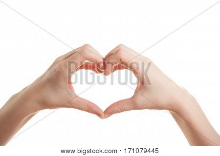 Hands of the girl show the fingers of the hands of the heart on an isolated white background