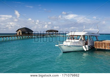 Noonu Attol Maldives - December 07 2016: Wooden pier in Luxury hotel in Iru Fushi island Maldives December 07 2016