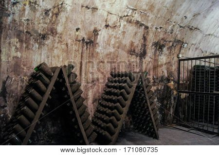 Dusty bottles in the stands. Former Russian winery Abrau Durso.