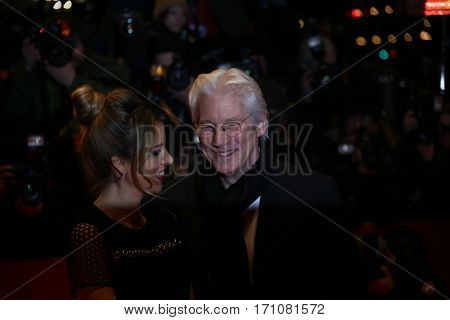 Richard Gere and  Alejandra Silva kiss on the red carpet prior the 'The Dinner' premiere during the 67th Berlinale Film Festival Berlin at Berlinale Palace on February 10, 2017 in Berlin, Germany.