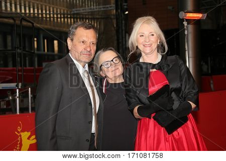 Miroslav Krobot,  Agnieszka Holland, Agnieszka Mandat arrive on the red carpet for the premiere of the film 'Pokot' (Spoor)  at the 67th Berlinale film festival in Berlin on February 12, 2017