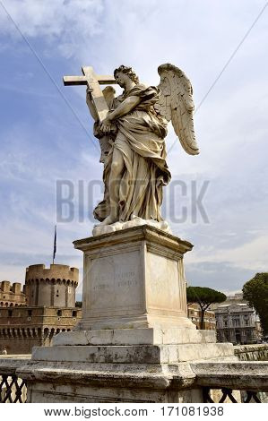 Rome Italy - September 15 2016 : Angel with the Cross on St. Angelo Bridge in Rome