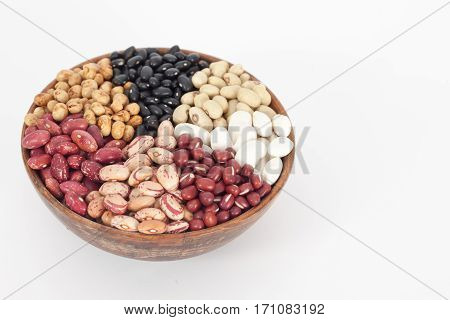Assortment of different types of beans - red beans, chickpeas, peas in wooden bowl