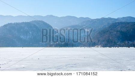 frozen lake Bled unique phenomenon many people on ice walking