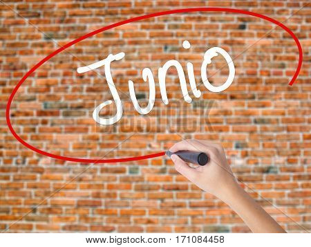 Woman Hand Writing Junio (june In Spanish)   With Black Marker On Visual Screen