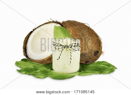 Jar of coconut oil and fresh coconuts isolated on white background.