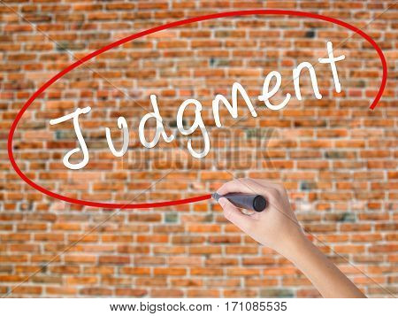 Woman Hand Writing Judgment With Black Marker On Visual Screen