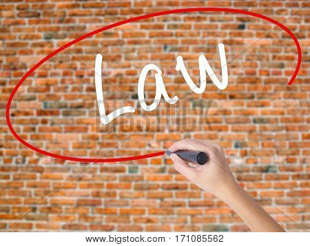 Woman Hand Writing Law With Black Marker On Visual Screen