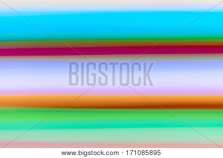 horizontal streaks of light in shades of turquoise, seafoam and lavender