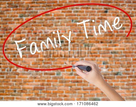 Woman Hand Writing Family Time With Black Marker On Visual Screen
