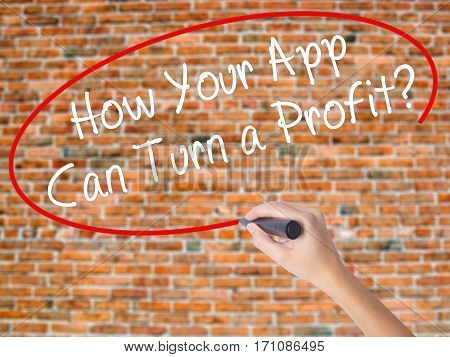 Woman Hand Writing How Your App Can Turn A Profit? With Black Marker On Visual Screen