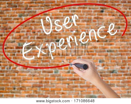 Woman Hand Writing User Experience With Black Marker On Visual Screen
