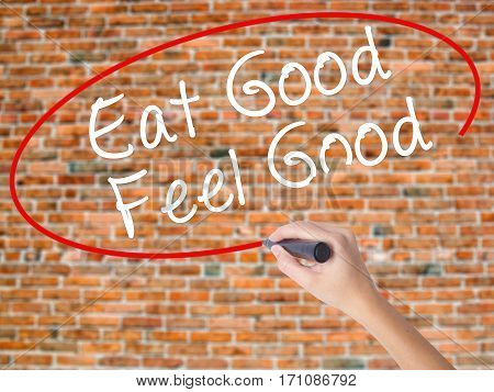 Woman Hand Writing Eat Good Feel Good With Black Marker On Visual Screen