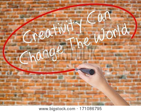 Woman Hand Writing Creativity Can Change The World With Black Marker On Visual Screen