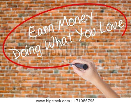 Woman Hand Writing Earn Money Doing What You Love With Black Marker On Visual Screen