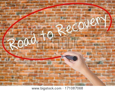 Woman Hand Writing Road To Recovery With Black Marker On Visual Screen