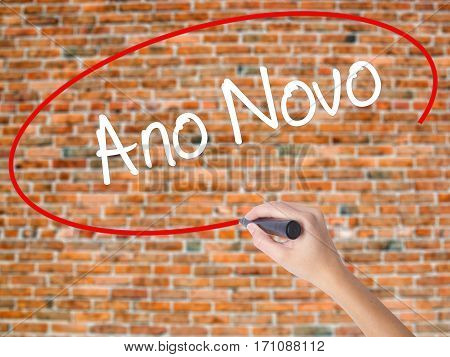"""Woman Hand Writing """"ano Novo"""" (in Portuguese: New Year) With Black Marker On Visual Screen"""