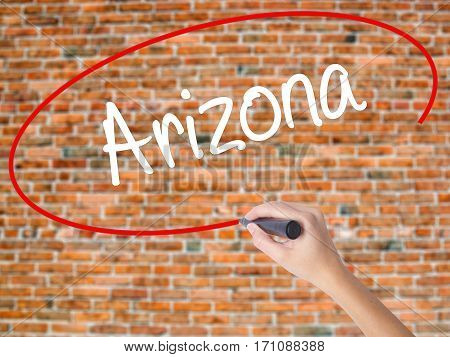 Woman Hand Writing  Arizona  With Black Marker On Visual Screen