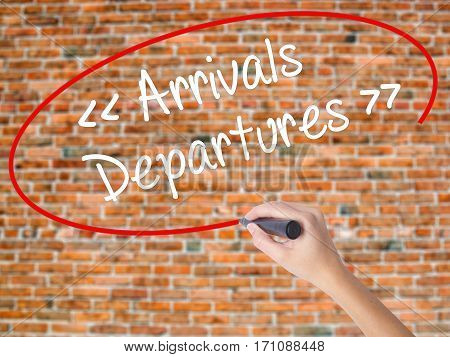Woman Hand Writing Arrivals - Departures With Black Marker On Visual Screen.