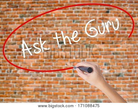Woman Hand Writing Ask The Guru With Black Marker On Visual Screen