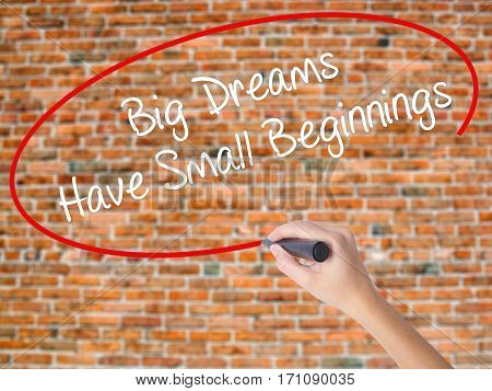 Woman Hand Writing Big Dreams Have Small Beginnings With Black Marker On Visual Screen