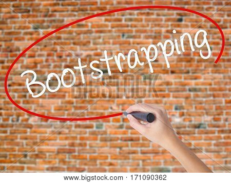 Woman Hand Writing Bootstrapping With Black Marker On Visual Screen