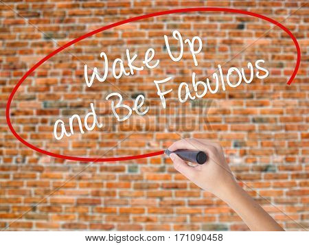 Woman Hand Writing Wake Up And Be Fabulous With Black Marker On Visual Screen
