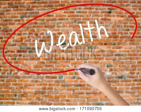 Woman Hand Writing Wealth With Black Marker On Visual Screen