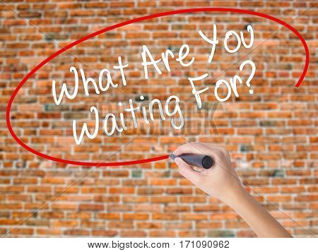 Woman Hand Writing What Are You Waiting For?  With Black Marker On Visual Screen