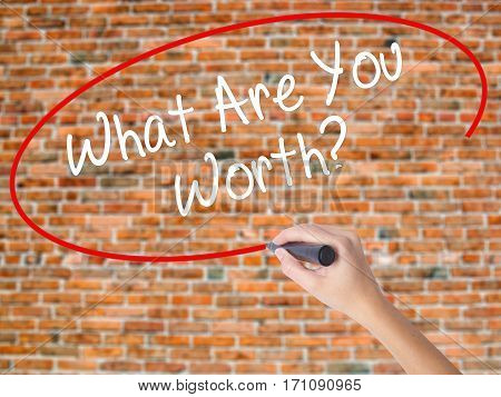 Woman Hand Writing What Are You Worth? With Black Marker On Visual Screen.