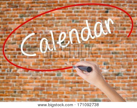Woman Hand Writing Calendar   With Black Marker On Visual Screen