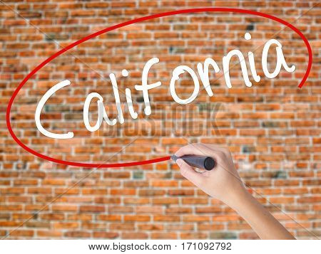 Woman Hand Writing California With Black Marker On Visual Screen