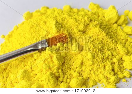 Yellow pigment on the white background for painting